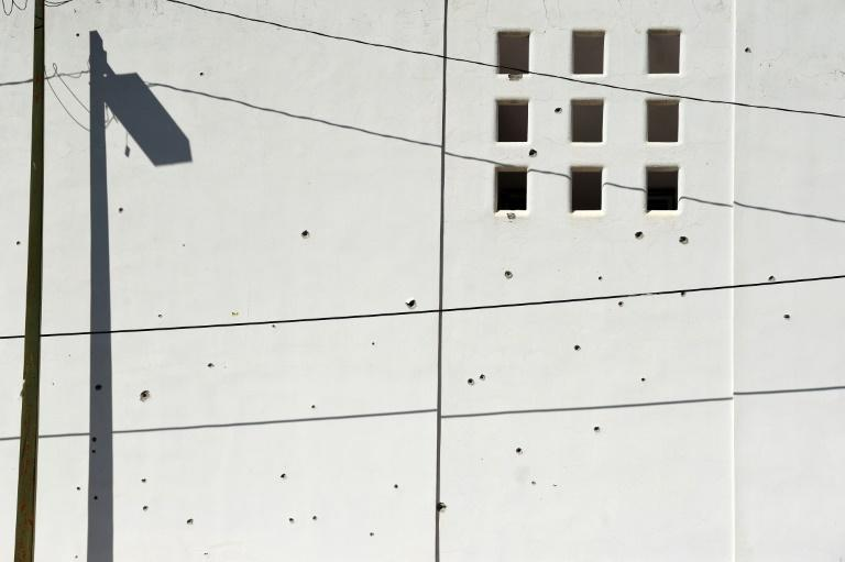 A wall riddled with bullet holes is seen after heavily armed gunmen waged an all-out battle against Mexican security forces in Culiacan (AFP Photo/ALFREDO ESTRELLA)