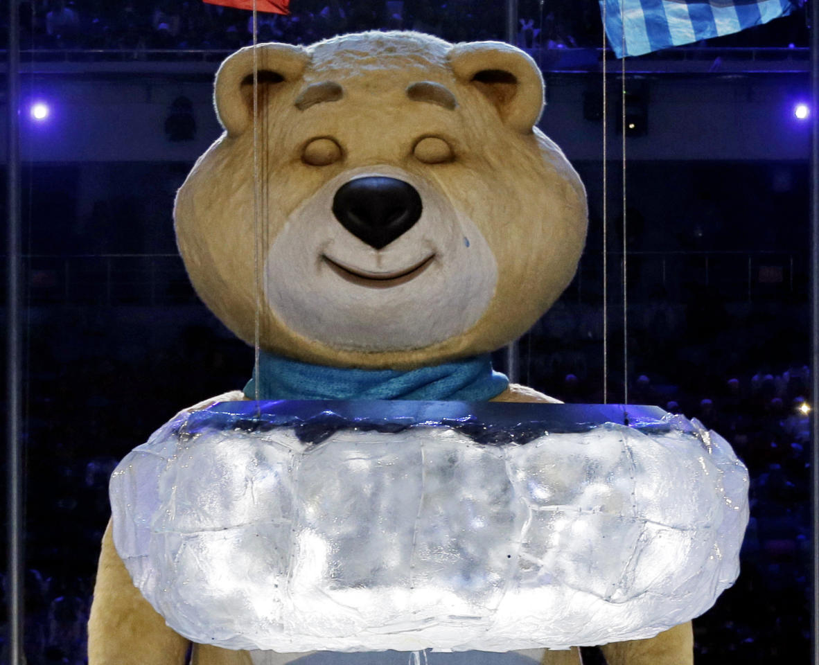 One of the Sochi Olympic mascots sheds a tear after extinguishing the Olympic flame during the closing ceremony of the 2014 Winter Olympics, Sunday, Feb. 23, 2014, in Sochi, Russia. (AP Photo/Charlie Riedel)