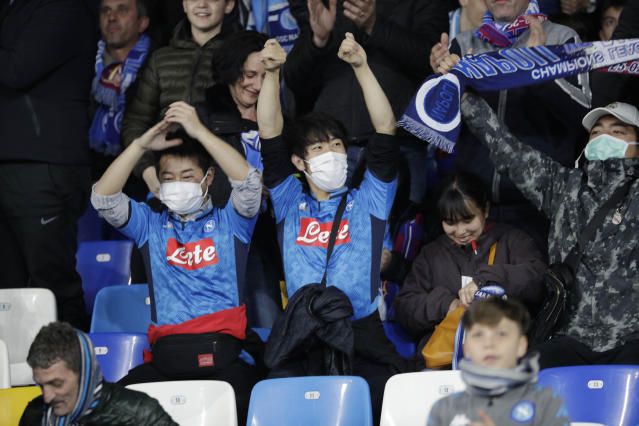 Napoli's fans wait for the start of the Champions League, Round of 16, first-leg soccer match between Napoli and Barcelona, at the San Paolo Stadium in Naples, Italy, Tuesday, Feb. 25, 2020. (AP Photo/Andrew Medichini)