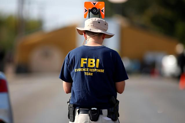 An FBI agent investigates the site of the shooting at the First Baptist Church of Sutherland Springs, Texas. (Photo: Jonathan Bachman/Reuters)