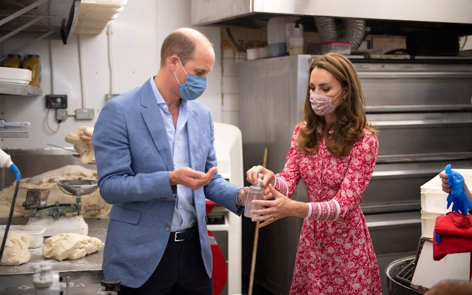 William and Kate in the Beigel Bake Brick Lane Bakery kitchen - AFP