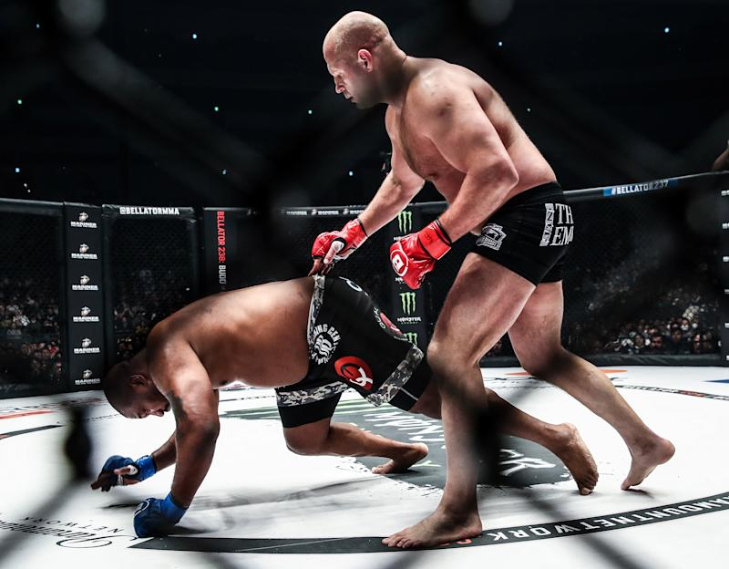 SAITAMA, JAPAN - DECEMBER 29, 2019: American MMA fighter Quinton 'Rampage' Jackson (L) and his Russian rival Fedor Emelianenko struggle in their Bellator 237 heavyweight main event at Saitama Super Arena; Bellator 237 is a cross-promotional event between Bellator MMA and the Rizin Fighting Federation. Valery Sharifulin/TASS (Photo by Valery Sharifulin\TASS via Getty Images)