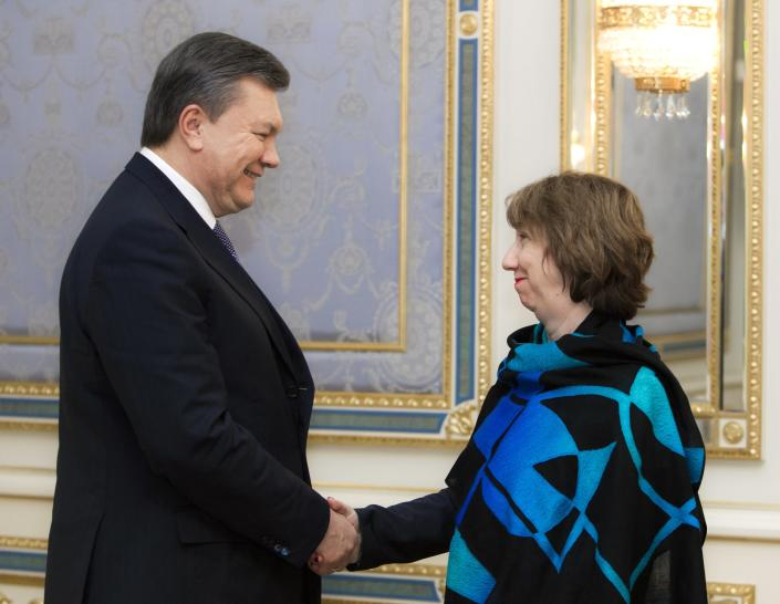 Ukraine's President Viktor Yanukovych, left, greets EU foreign policy chief Catherine Ashton prior their talks in Kiev, Ukraine, Wednesday, Dec. 11, 2013. At least, European Union leaders can count on support from the tens of thousands of demonstrators who throng the center of Kiev on a regular basis as a tool to pressure Yanukovych to change his mind. (AP Photo/ Mykhailo Markiv, Pool)