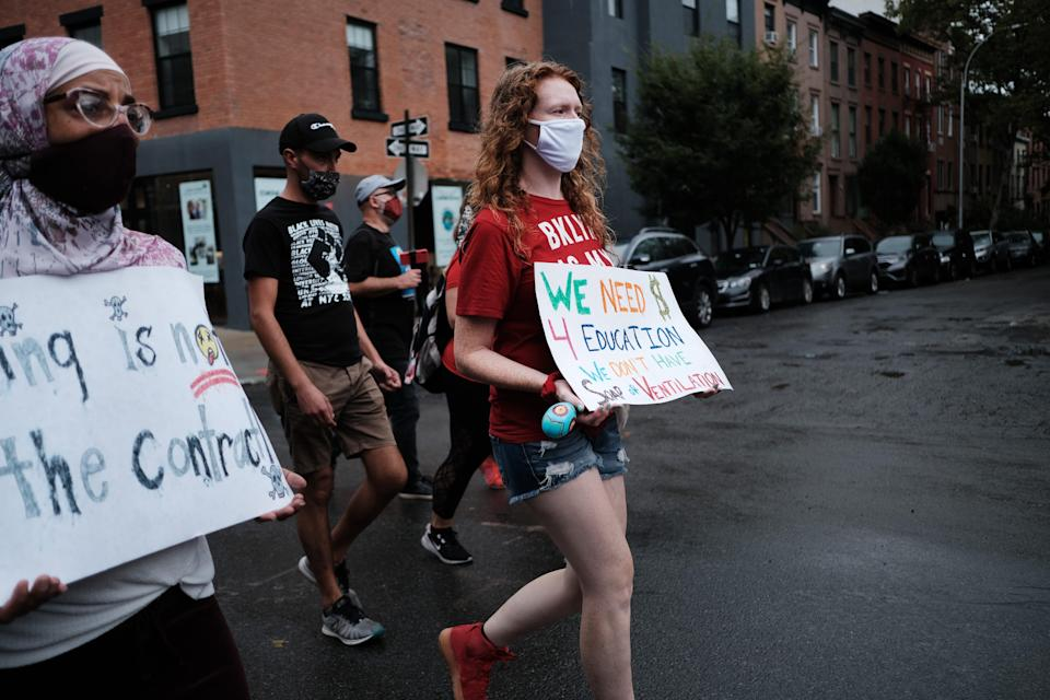 A call Thursday by the country's second-largest teachers union to fully reopen schools in the fall could lift a key barrier to a return to a traditional school schedule, given the concerns over safety raised by many union members, like these who marched through Brooklyn last September.
