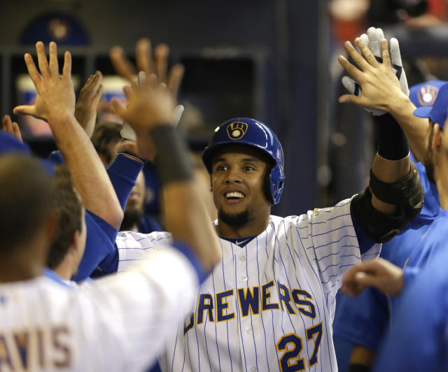 Milwaukee Brewers' Carlos Gomez reacts in the dugout after his home run off Pittsburgh Pirates starting pitcher Edinson Volquez during the first inning of a baseball game Saturday, April 12, 2014, in Milwaukee. (AP Photo/Jeffrey Phelps)