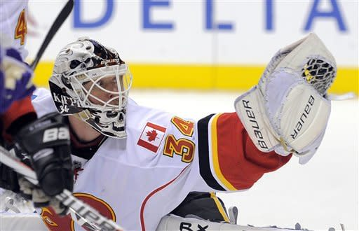 Calgary Flames goalie Miikka Kiprusoff, of Finland, makes a glove save during the second period of an NHL hockey game against the Los Angeles Kings, Saturday, Feb. 18, 2012, in Los Angeles. (AP Photo/Mark J. Terrill)