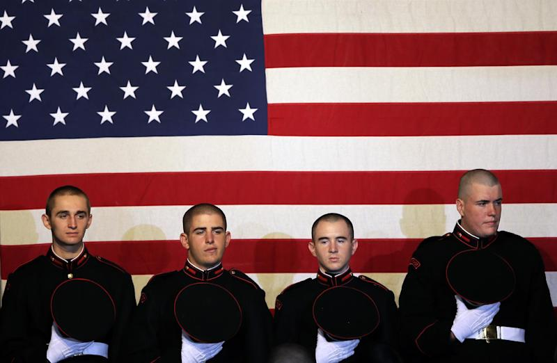 Cadets wait to take their seats before a campaign rally for Republican presidential candidate, former Massachusetts Gov. Mitt Romney at the Valley Forge Military Academy, Friday, Sept. 28, 2012, in Wayne, Pa.. (AP Photo/Matt Slocum)