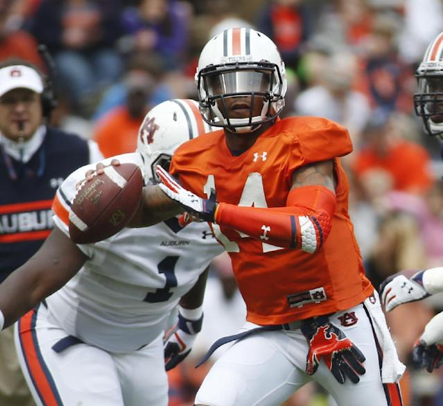 Auburn quarterback Nick Marshall (14) throws in the first half of the annual A Day spring inter squad college football game Saturday, April 19, 2014 in Auburn, Ala. (AP Photo/John Bazemore)