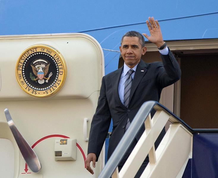 President Barack Obama waves as he gets off Air Force One upon his arrival at King Khalid International airport in Riyadh, Saudi Arabia, Friday, March 28, 2014. President Barack Obama is in Saudi Arabia to reassure the key Gulf ally that his commitment to the Arab world isn't wavering. (AP Photo/Pablo Martinez Monsivais)