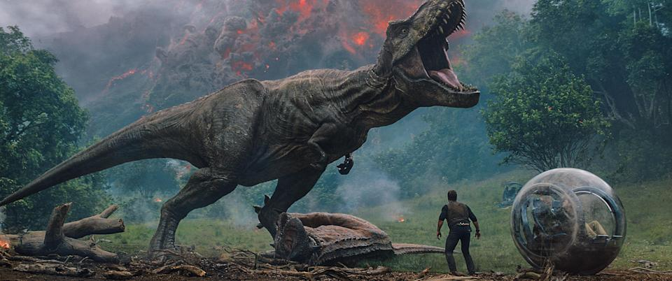 The T. rex takes down a Carnotaurus. (Photo: Universal Pictures)