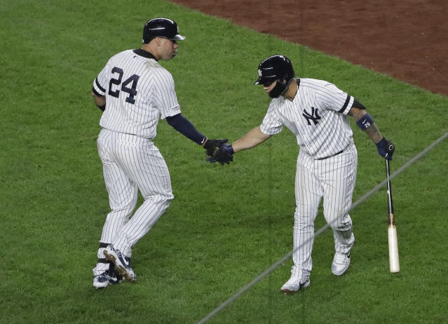 New York Yankees' Gary Sanchez (24) celebrates with Gleyber Torres after hitting a home run during the fifth inning of the team's baseball game against the Minnesota Twins on Friday, May 3, 2019, in New York. (AP Photo/Frank Franklin II)