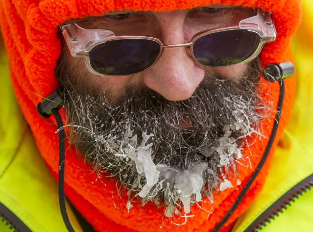 Ice forms on the beard of Bob Schweitzer as he helps clear ice and snow from the seats at Lambeau Field on Friday, Jan. 3, 2014, in Green Bay, Wis., in preparation for Sunday's NFl football wild-card playoff game between the Green Bay Packers and San Francisco 49ers. (AP Photo/Mike Roemer)