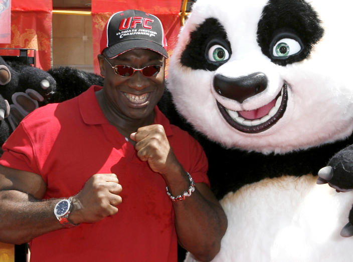 """In this Sunday, June 1, 2008 photo, actor Michael Clarke Duncan poses with """"Kung Fu Panda"""" at the premiere of the movie in the Hollywood area of Los Angeles. Duncan has died at the age of 54 on Monday, Sept. 3, 2012 in a Los Angeles hospital after nearly two months of treatment following a July 13, 2012 heart attack, his fiancee, the Rev. Omarosa Manigault, said. (AP Photo/Gus Ruelas)"""