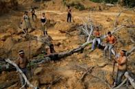 Indigenous people from the Mura tribe show a deforested area in unmarked indigenous lands inside the Amazon rainforest near Humaita