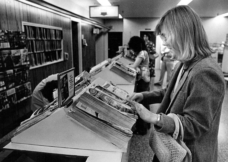 A woman looking at Sears catalogue in 1981.