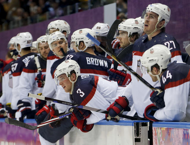 Team USA watches late in the third period against Canada during a men's semifinal ice hockey game at the 2014 Winter Olympics, Friday, Feb. 21, 2014, in Sochi, Russia. Canada won 1-0. (AP Photo/Petr David Josek)