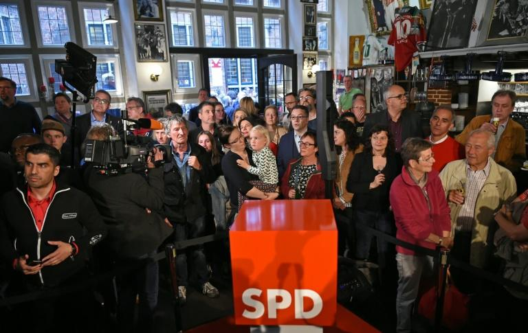 Exit polls show Germany's Social Democratic Party  which was not only toppled from second place at European polls by the Greens, but also suffered a humiliating loss at state elections in its stronghold Bremen
