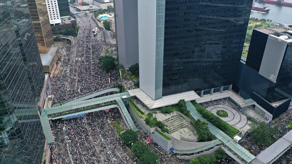 Extradition bill protesters occupy Harcourt Road and gather outside the Legislative Council Complex in Tamar on June 12, 2019. Photo: May Tse
