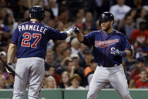 Minnesota Twins designated hitter Ryan Doumit (9) celebrates his solo home run with Chris Parmelee (27) during the seventh inning of a baseball game against the Boston Red Sox at Fenway Park in Boston, Tuesday, May 7, 2013. (AP Photo/Elise Amendola)