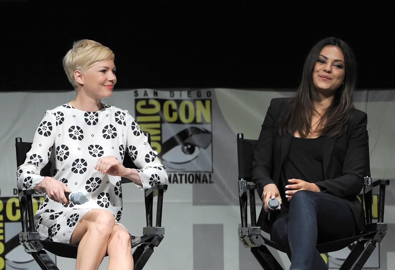 "SAN DIEGO, CA - JULY 12:  Actresses Michelle Williams (L) and Mila Kunis speak at the ""Oz: The Great and Powerful"" panel during Comic-Con International 2012 at San Diego Convention Center on July 12, 2012 in San Diego, California.  (Photo by Kevin Winter/Getty Images)"