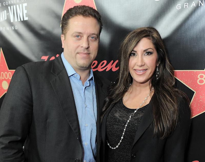 """FILE - This Nov. 30, 2012 file photo originally released by Walgreens shows Chris Laurita, left, and his wife Jacqueline Laurita, of """"The Real Housewives of New Jersey,"""" at Walgreens 8000th Store Opening in Los Angeles. Authorities say a man who told police that he was an attorney for the Lauritas falsely represented himself as a lawyer. A Paramus man claims Jacqueline and Christopher Laurita and Giuseppe """"Joe"""" Gorga attacked him as cameras rolled in Ridgewood on March 30. John Karagiorgis filed a complaint, accusing the three of simple assault and making terroristic threats. (AP Photo/Walgreens, Jordan Strauss, file)"""