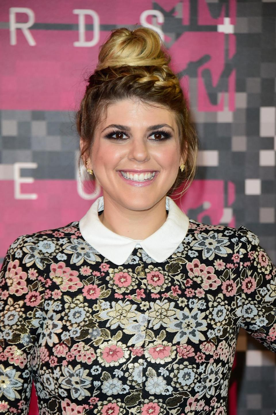 <p>The Awkward star walked the red carpet with a slightly messy top knot and wrap-around braids.</p><p>Source: Getty Images</p>