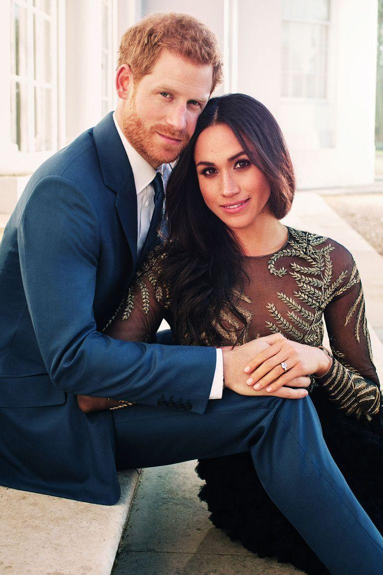 <p>Markle wore her hair down and swept over to one side for her official engagement portraits.</p>