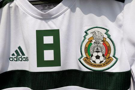 The logo of the Mexican national soccer team is pictured on a shirt on display for sale outside the Azteca stadium of Mexican First Division in Mexico City, Mexico May 13, 2018. REUTERS/Henry Romero
