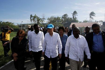 UN Secretary General Ban Ki Moon (C) and Haitian interim Prime Minister Enex Jean-Charles (2nd L) walk in the MINUSTAH base during a visit after Hurricane Matthew in Les Cayes, Haiti, October 15, 2016. REUTERS/Andres Martinez Casares