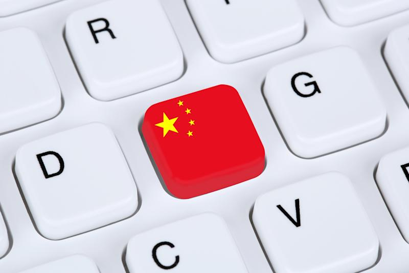 """A Chinese flag replacing the """"F"""" key on a computer keyboard."""