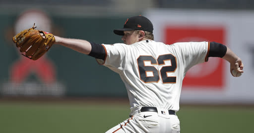 San Francisco Giants pitcher Logan Webb works against the Los Angeles Dodgers in the first inning of the first game of a baseball doubleheader Thursday, Aug. 27, 2020, in San Francisco. (AP Photo/Ben Margot)