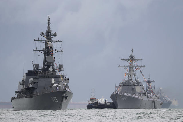 <p>Japan's destroyer JS Sazanami, left, the United State's Arleigh Burke-class guided missile destroyer USS Sterett, center, and South Korean destroyer ROKS Dae Jo Yeong, right rear, are anchored in the waters off RSS Singapura Changi Naval Base, May 15, 2017, in Singapore. As part of the Republic of Singapore Navy's 50th anniversary celebrations, 28 foreign warships from 20 navies gathered at the naval base and its surrounding waters to mark the occasion. (Photo: Wong Maye-E/AP) </p>