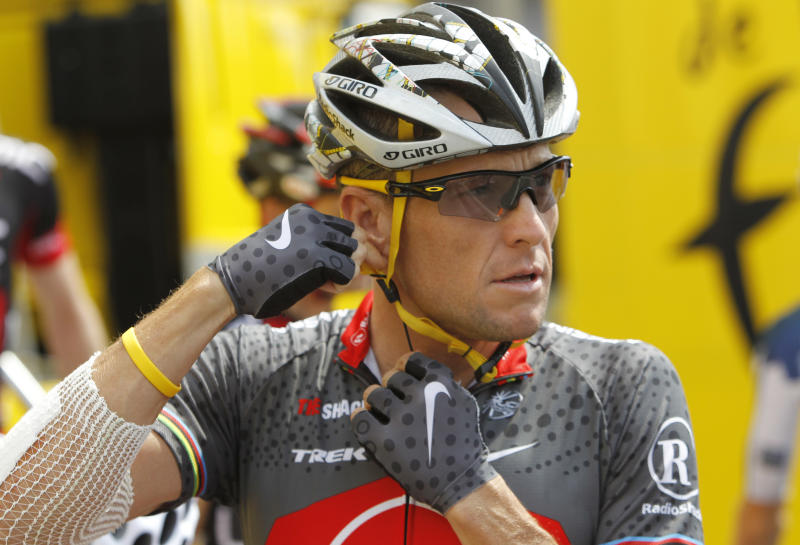 FILE - In this July 6, 2010 file photo, Lance Armstrong of the United States, arrives prior to the start of  the third stage of the Tour de France cycling race in Wanze, Belgium. Nike Inc. is cutting ties with the Livestrong cancer charity. The move by the sports company ends a nine-year relationship that helped the foundation raise more than $100 million and made the charity's signature yellow wristband an international symbol for cancer survivors. (AP Photo/Christophe Ena, FIle)