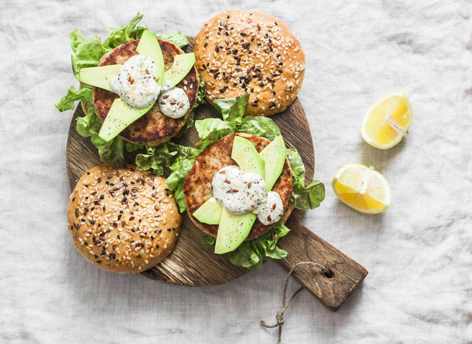 """<p>If you prefer seafood to beef, then these grilled tuna burgers are going to be your weeknight go-to. Make sure to buy high-quality tuna, as this fish is best served rare.</p> <p><a href=""""https://www.thedailymeal.com/recipes/tuna-burgers-wasabi-mayo-and-quick-cucumber-pickle-recipe?referrer=yahoo&category=beauty_food&include_utm=1&utm_medium=referral&utm_source=yahoo&utm_campaign=feed"""" rel=""""nofollow noopener"""" target=""""_blank"""" data-ylk=""""slk:For the Grilled Tuna Burgers recipe, click here."""" class=""""link rapid-noclick-resp"""">For the Grilled Tuna Burgers recipe, click here.</a></p>"""