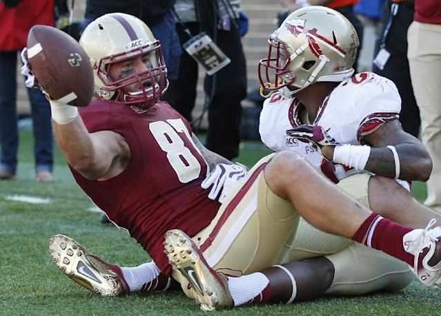 Boston College tight end C.J. Parsons (87) holds up the football after his leaping touchdown catch against Florida State defensive back P.J. Williams, right, during the first quarter of an NCAA college football game at Alumni Stadium in Boston, Saturday, Sept. 28, 2013. (AP Photo/Elise Amendola)
