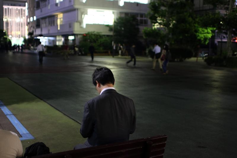 About 22.3% of Japanese employees work 50 hours or more each week on average, well above 12.7% in Britain, 11.3% in the US, and 8.2% in France, according to the Organisation for Economic Co-operation and Development (AFP Photo/Yoshikazu Tsuno)