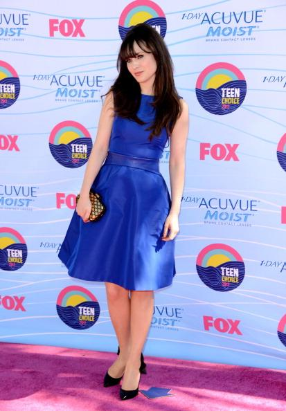 Actress Zooey Deschanel arrives at the 2012 Teen Choice Awards at Gibson Amphitheatre on July 22, 2012 in Universal City, California. (Photo by Jason Merritt/Getty Images)