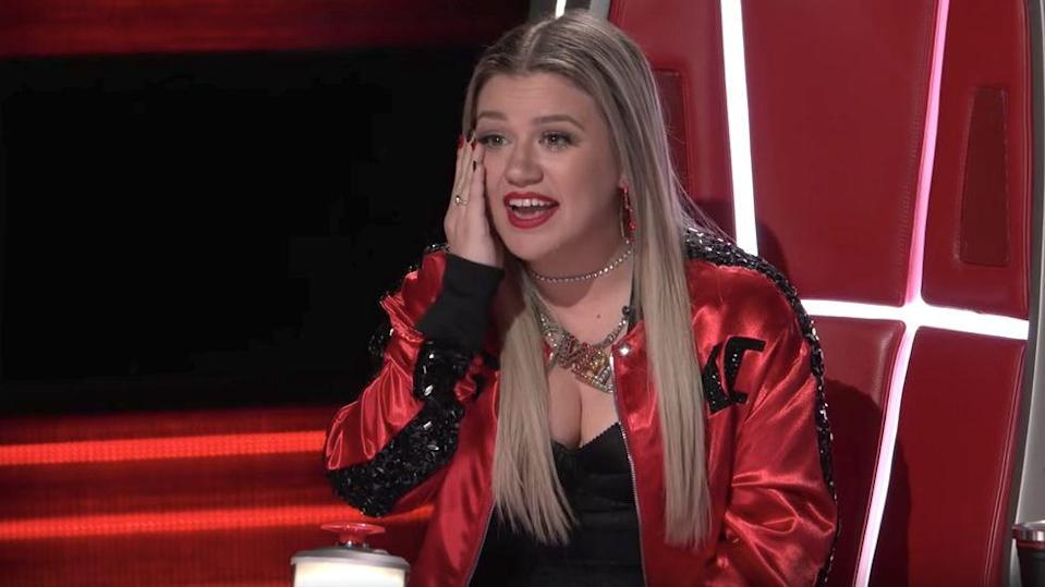 Kelly Clarkson is moved to tears by OneUp's love story. (Photo: NBC)