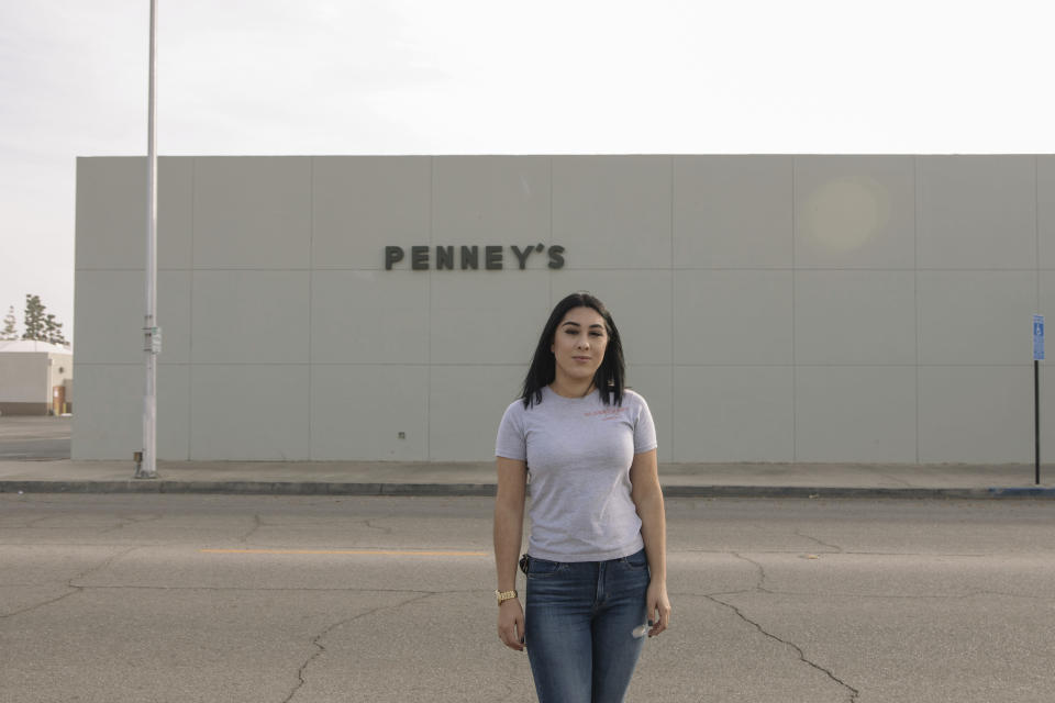 Alexandra Orozco stands for a portrait outside of the closed J.C. Penney, where she used to work, in Delano, Calif., on Sunday, Dec. 6, 2020. The 118-year-old department store chain filed for bankruptcy in May. (Madeline Tolle/The Fuller Project via AP)