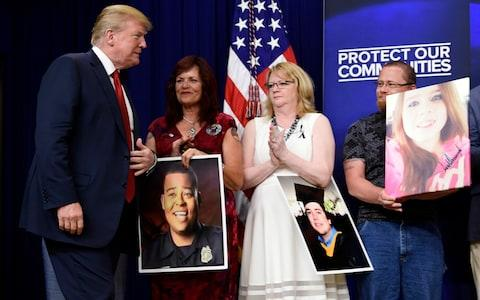 On Friday, Mr Trump hosted families of people killed by undocumented immigrants as he sought to regain the political initiative - Credit: Susan Walsh/AP