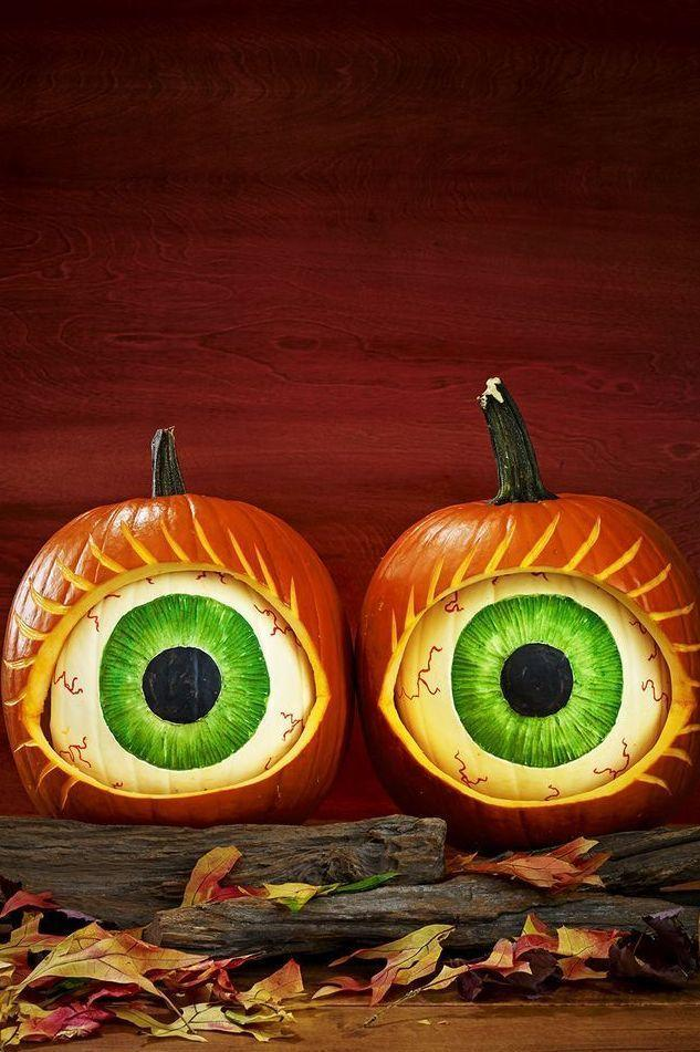 <p>Opt for a creepy statement by placing white pumpkins inside bigger orange pumpkins to resemble eyeballs. Stick two pumpkin creations side by side for extra impact. </p>