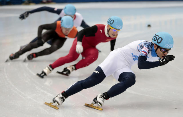 Victor An of Russia leads the field in a men's 500m short track speedskating semifinal at the Iceberg Skating Palace during the 2014 Winter Olympics, Friday, Feb. 21, 2014, in Sochi, Russia. (AP Photo/Ivan Sekretarev)