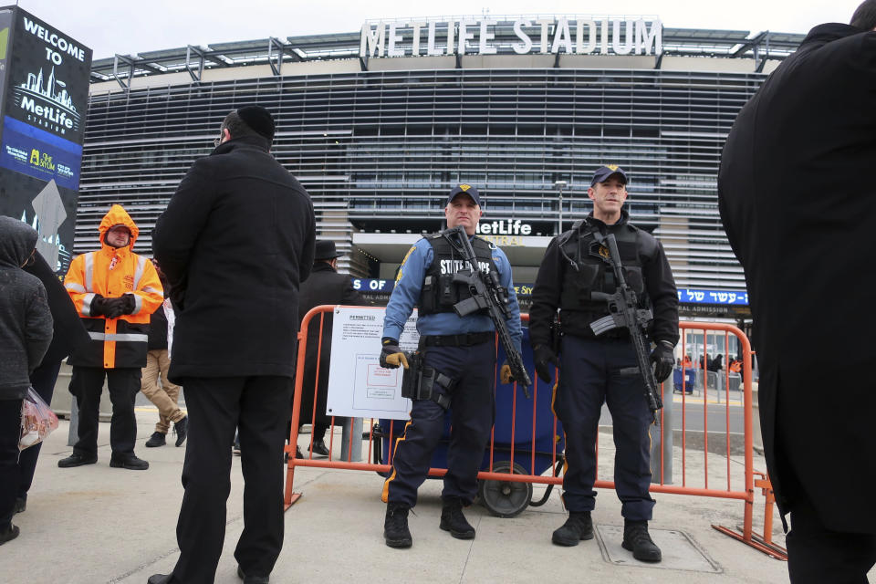 New Jersey State Police officers stand guard in front of MetLife Stadium Wednesday, Jan. 1, 2020, in East Rutherford, N.J., at an event called Siyum HaShas, that celebrates the completion of the reading of the Babylonian Talmud, a process that takes 7 1/2 years The large gathering of Jews drew a significant security presence after recent anti-Semitic attacks in the New York City area. (AP Photo/Ted Shaffrey)