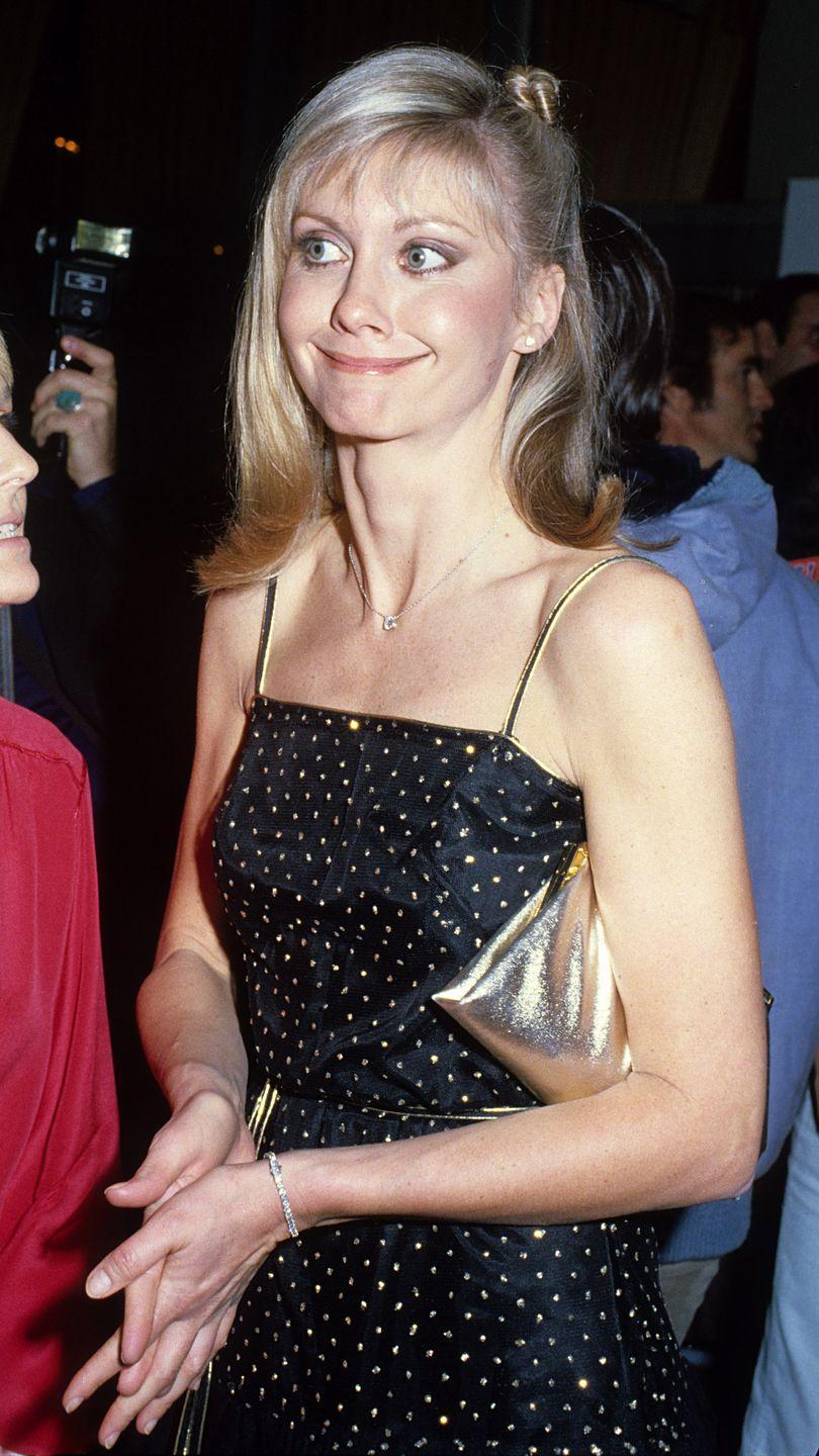 <p>The <em>Grease</em> singer and actress kept it simple in 1978, wearing this beaded spaghetti-strap dress.</p>