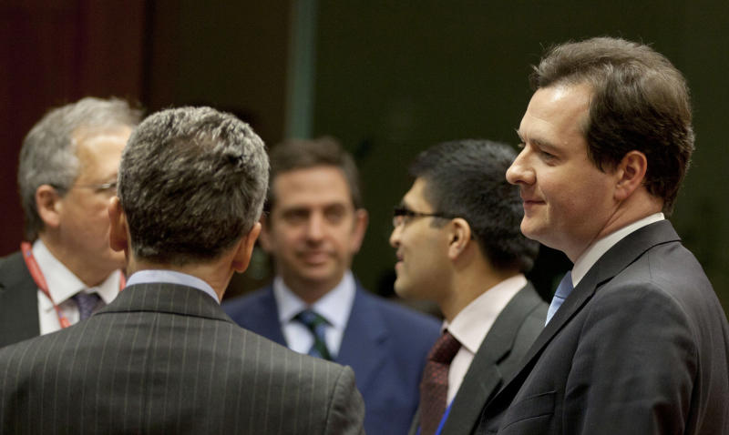 British Finance Minister George Osborne, right, speaks with Italian Economy Minister Vittorio Grilli, second left, during a meeting of EU finance ministers in Brussels on Tuesday, March 5, 2013. European Union finance ministers were expected Tuesday to give wide political approval to capping bankers' bonuses, with Britain being the only country of the 27-nation bloc staunchly opposing the measure, diplomats said. (AP Photo/Virginia Mayo)