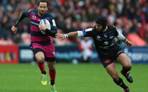 <span>Danny Cipriani is tackled by Castres' Armand Batile during the European Champions Cup</span> <span>Credit: PA </span>