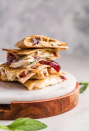 """<p>Calling all cheese lovers: You'll love this melty meal. It's filled with Cheddar, Asiago, and pepper Jack cheese.</p><p><strong>Get the recipe at <a href=""""https://www.thecookierookie.com/thanksgiving-leftovers-quesadilla/"""" rel=""""nofollow noopener"""" target=""""_blank"""" data-ylk=""""slk:The Cookie Rookie"""" class=""""link rapid-noclick-resp"""">The Cookie Rookie</a>.</strong></p><p><strong><strong><a class=""""link rapid-noclick-resp"""" href=""""https://www.amazon.com/Tramontina-80114-535DS-Professional-Restaurant/dp/B009HBKQ16/r?tag=syn-yahoo-20&ascsubtag=%5Bartid%7C10050.g.1064%5Bsrc%7Cyahoo-us"""" rel=""""nofollow noopener"""" target=""""_blank"""" data-ylk=""""slk:SHOP SKILLETS"""">SHOP SKILLETS</a></strong><br></strong></p>"""