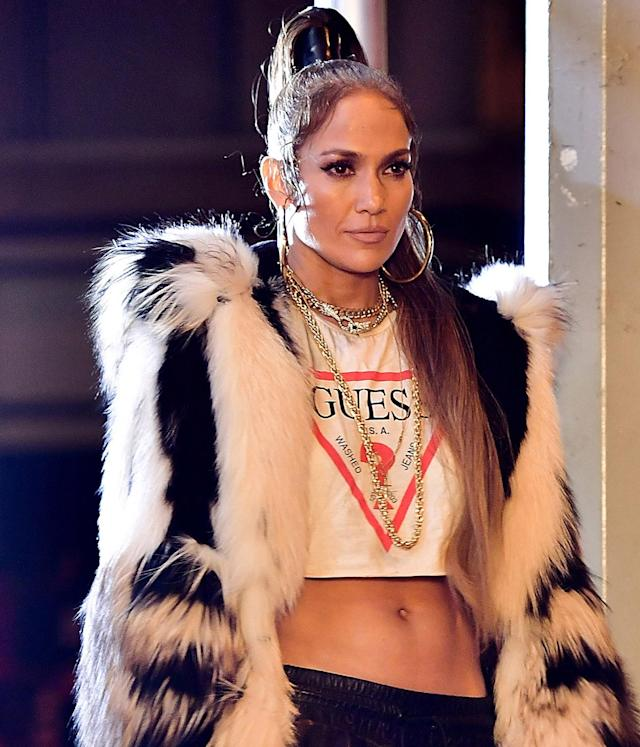 <p>J.Lo was seen on location for her new music video in Manhattan rocking a fly outfit, high pony, sultry smokey eye makeup and, of course, nude lipstick. (Photo by James Devaney/GC Images) </p>