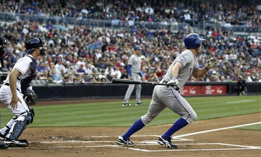 Texas Rangers' David Murphy, right, grounds a two run single up the middle against the San Diego Padres during the first inning of an interleague baseball game, Monday, June 18, 2012, in San Diego. (AP Photo/Lenny Ignelzi)
