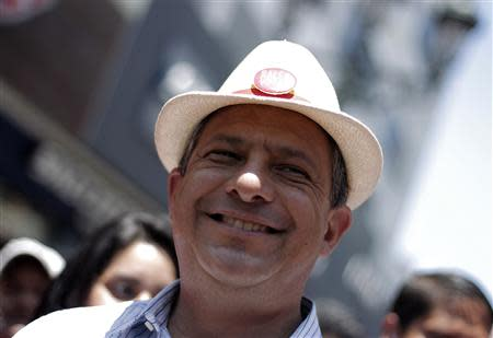 Luis Guillermo Solis, presidential candidate of the Citizens' Action Party, smiles during a walk in San Jose